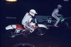 The TT about to suck the goggles off Jason Buckley on a KX250